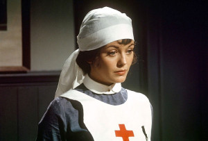 Lesley-Anne Down as Georgina, Aristo cum Red Cross Nurse